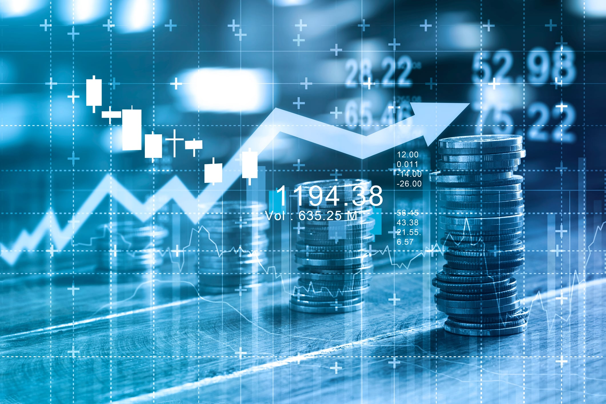 Finance and business concept. Investment graph and rows growth and of coins on table, blue color tone.