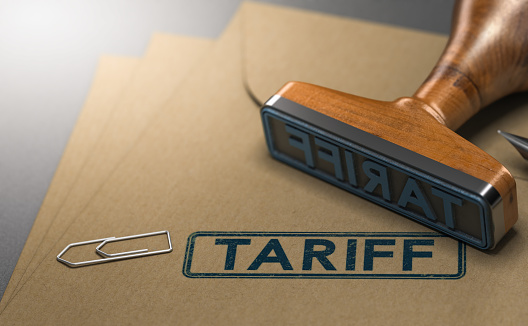 3D illustration of a rubber stamp with the word tariff stamped on paper background. Concept of taxes or duties on imported goods.