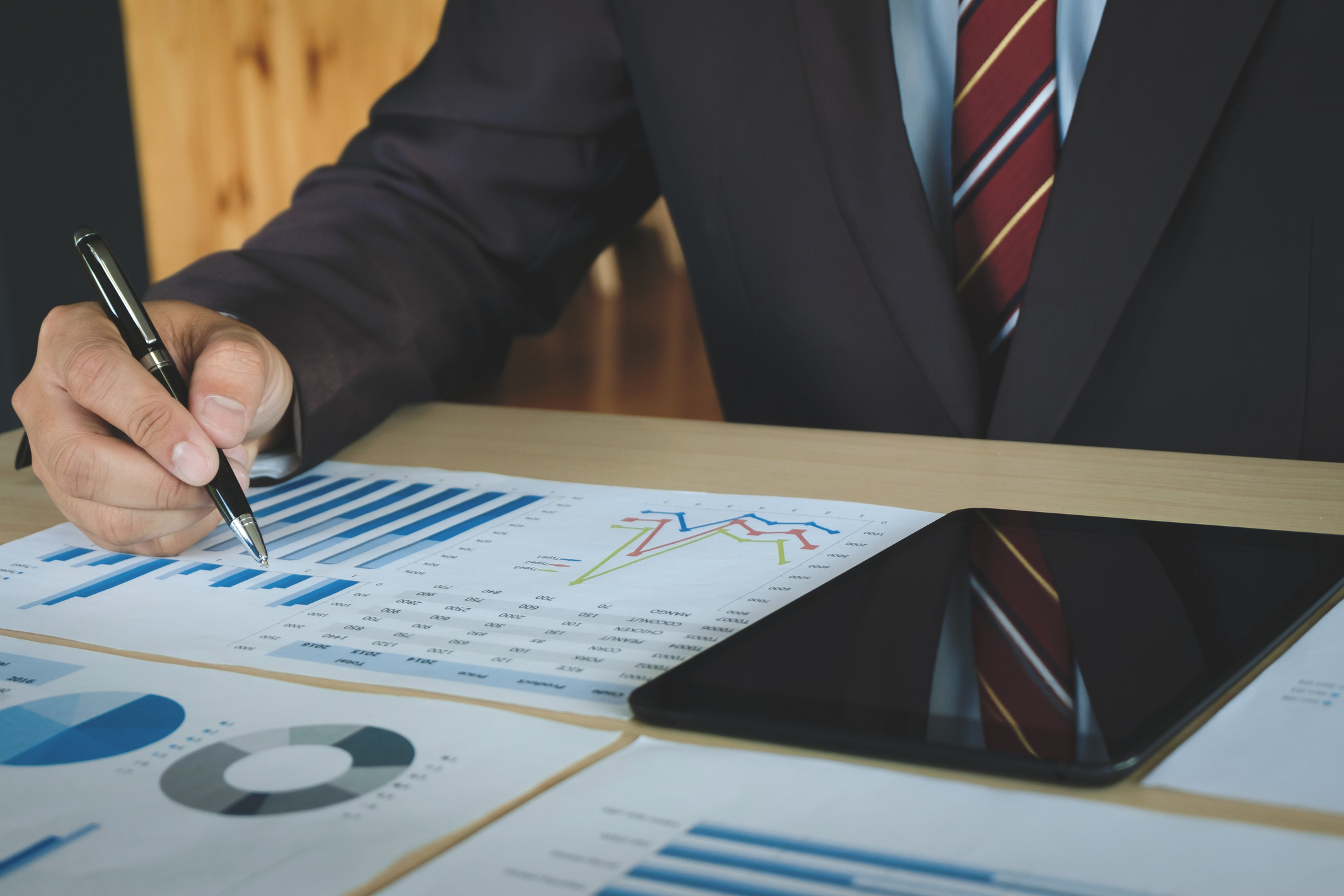 Midsection Of Businessman Working On Graph In Office