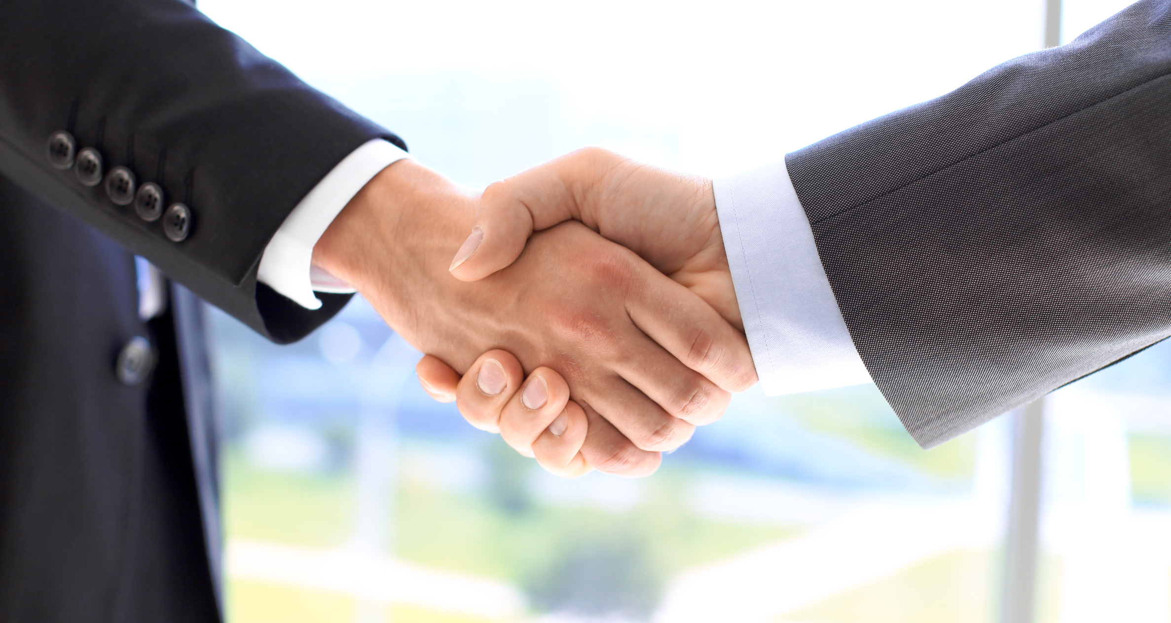Business people shaking hands as a sign of agreement. Success concept.