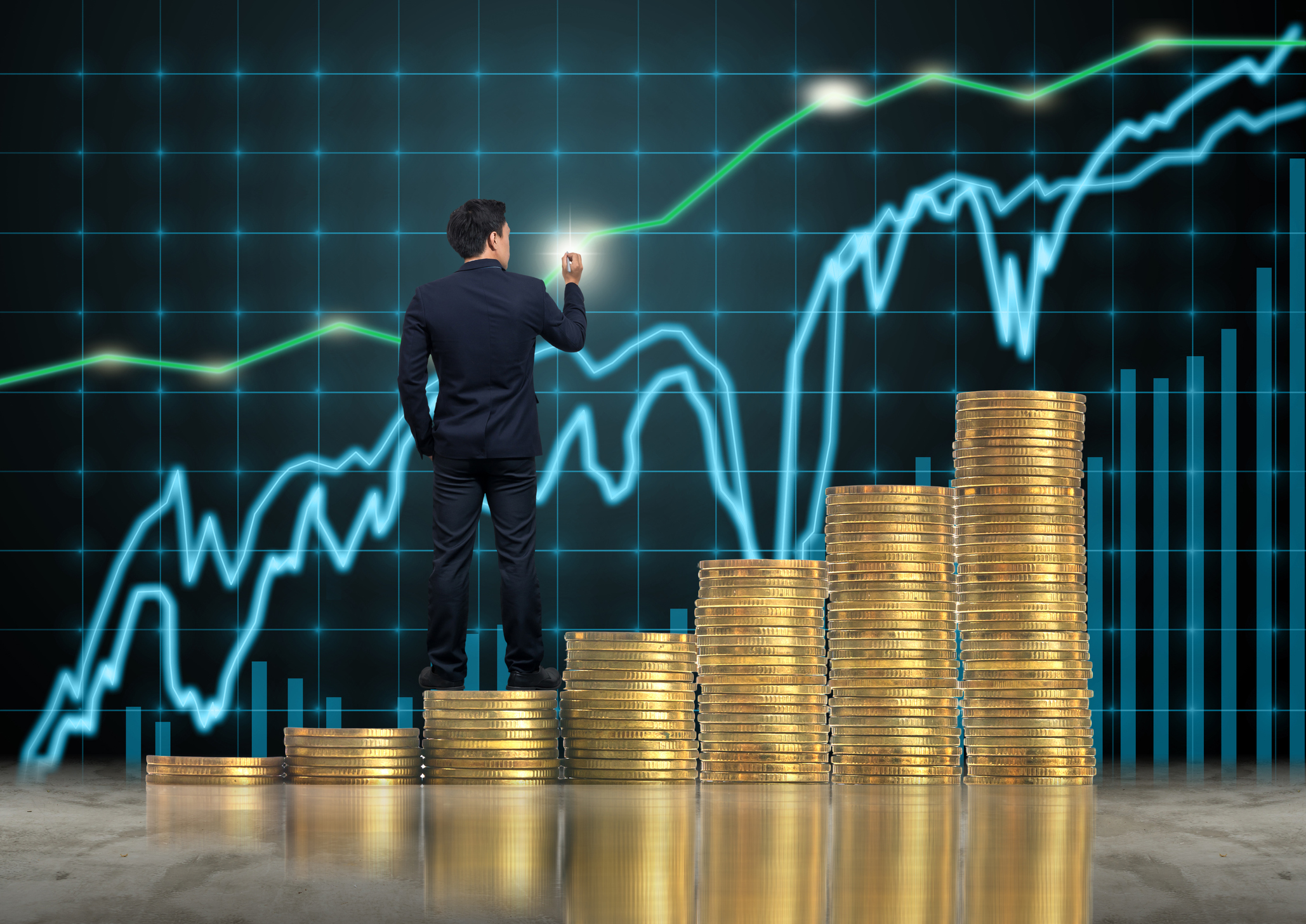 Businessman standing over the stack of gold coins and drawing the trading graph of Stock exchange market background, Business trading and education concept