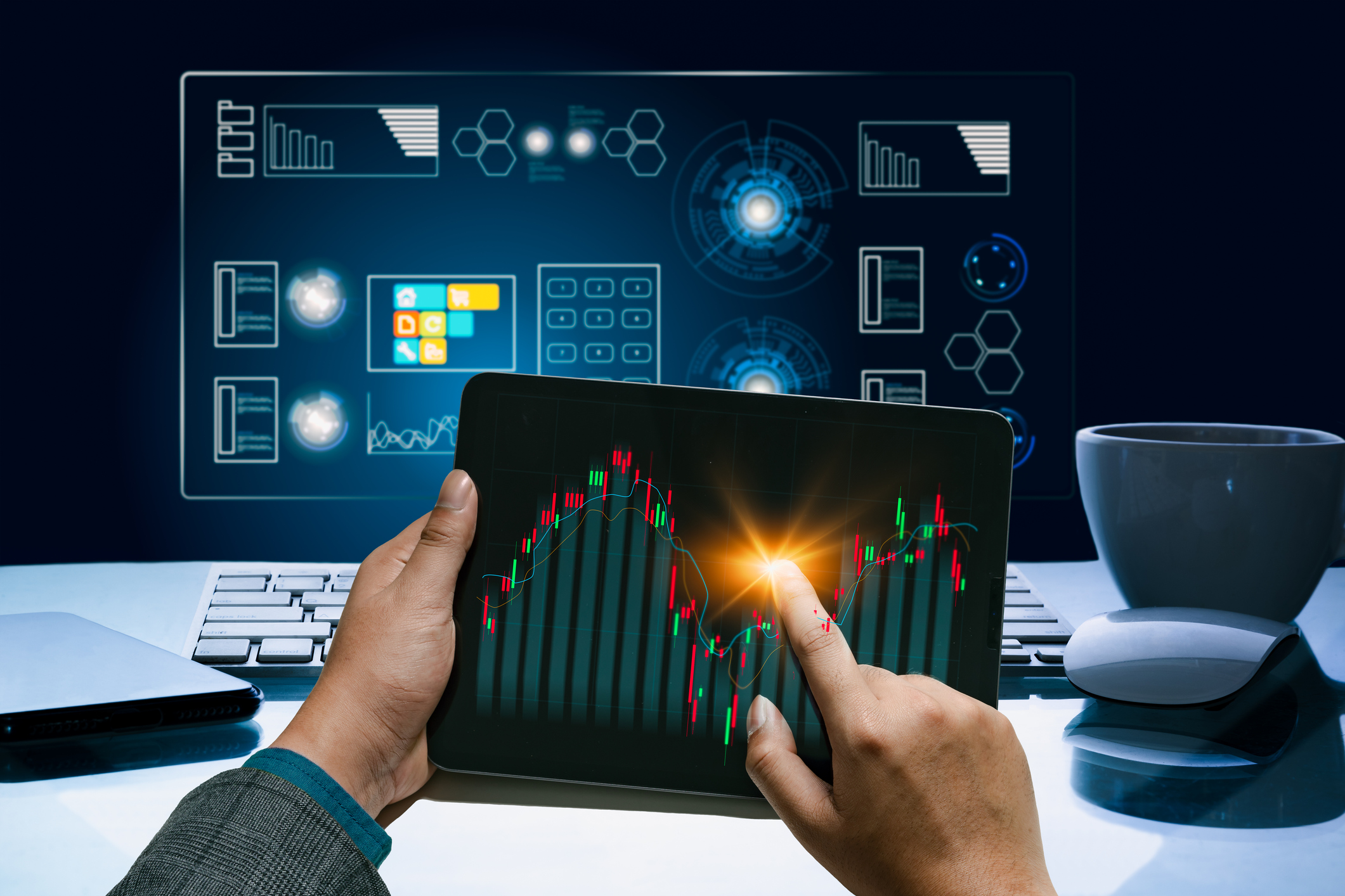 Businessman using tablet device to check market data and economic growth graph chart. Business strategy. Digital marketing.
