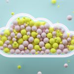 Digital generated image of yellow and pink spheres inside glowing cloud shape on blue background.