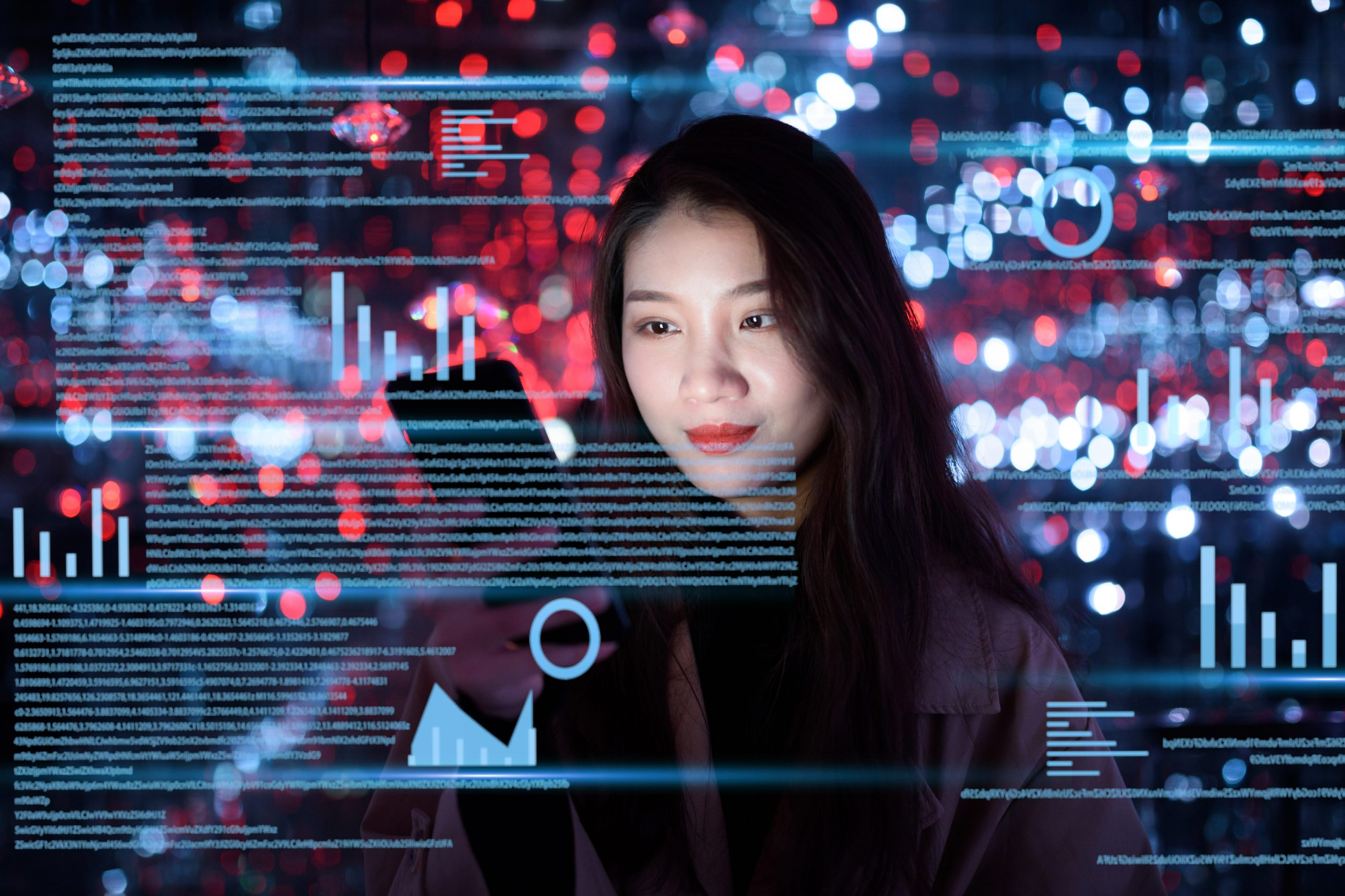 young woman uses mobile phone on virtual visual screen at night